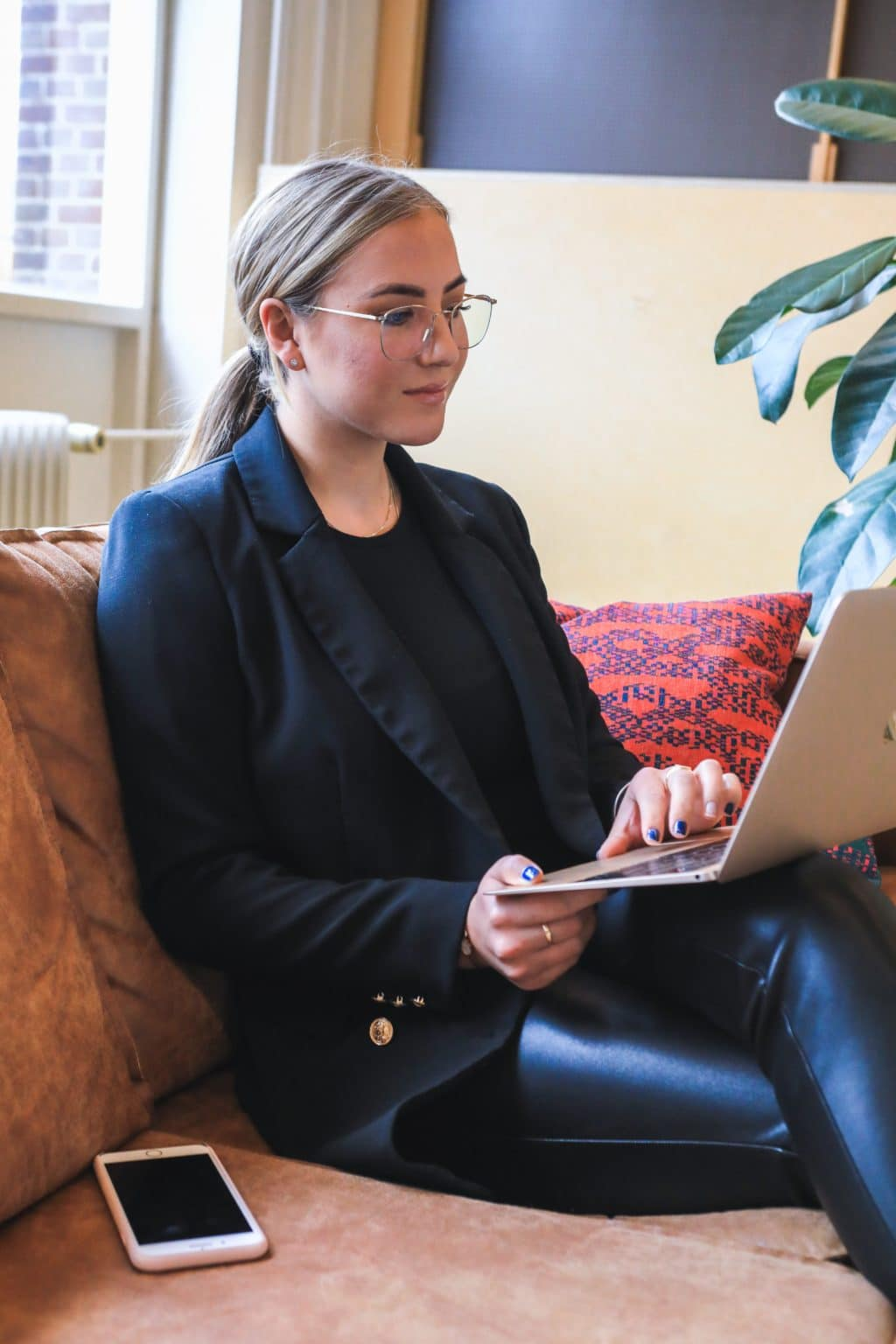 Remote interview with a young woman sitting on a couch